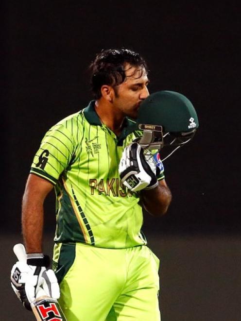 Pakistan's Sarfraz Ahmed kisses his helmet as he celebrates reaching his century against Ireland....
