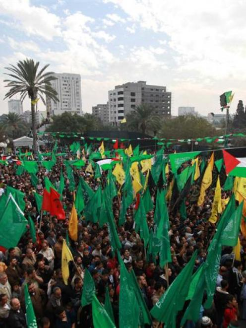 Palestinians celebrate what they claim is a victory over Israel after an eight-day conflict,...