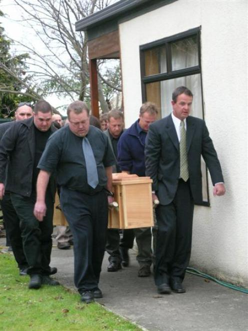 Pallbearers (from left) Mark Clayton, Lance Clayton, Greg King, Ritchie White, Peter White and...