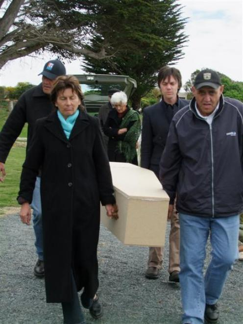 Pallbearers (from left, rear) John Scott and Aaron Scott and (front) Jenny O'Connell and Bruce...