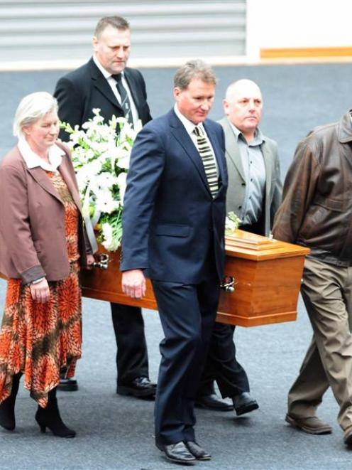 Pallbearers, including Olympian Danyon Loader, carry Laing's coffin. Photo by Craig Baxter.