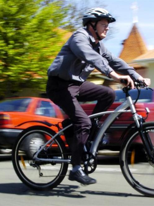 Palmerston man Chris Walker rides one of the electrically-assisted bicycles he hopes will become...