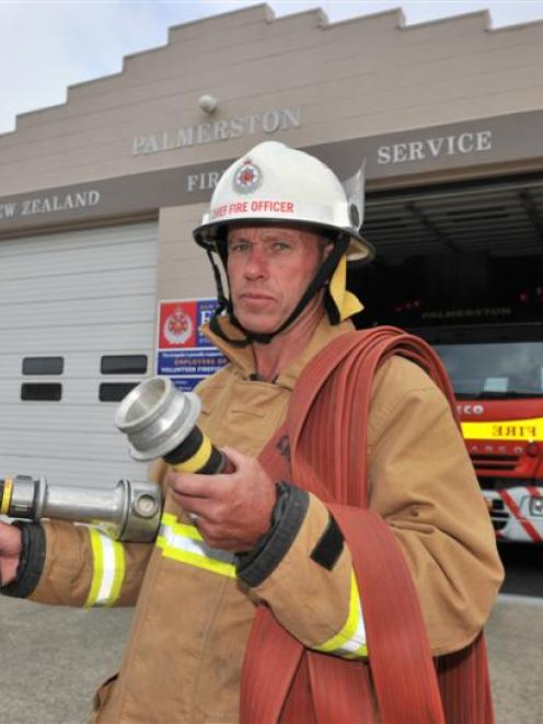 Palmerston Volunteer Fire Brigade chief fire officer Gary Johnston holds a dry fire hose.  Photo...