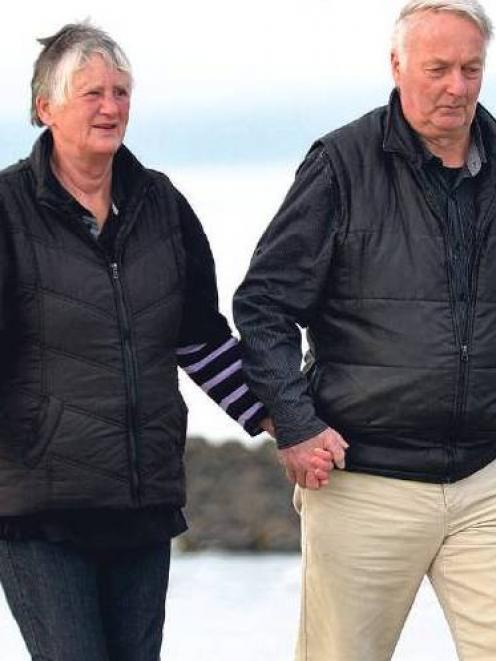 Pam and Paddy Paterson enjoy a walk on the beach at Kaka Point yesterday. Photo Peter McIntosh