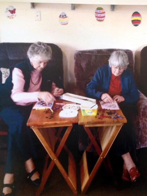 Pam Gale (left) and Gwen Staynes work on their Easter craft at the Mosgiel Elderly Care Trust...