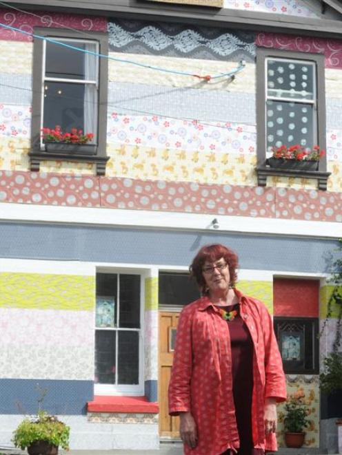 Pamela Brown and her wallpaper house. Photo by Craig Baxter.