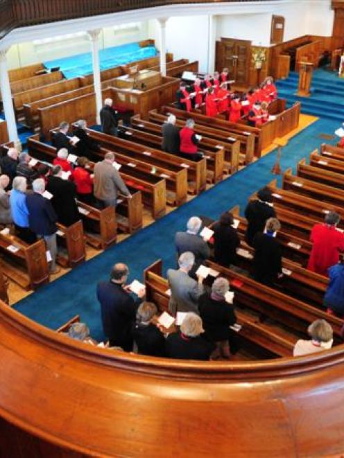 Parishioners worship at Knox Church for the final time yesterday before the church was closed for...