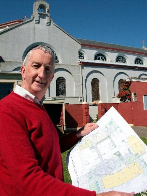 Park project ...  St Patrick's redevelopment committee chairman Sean Toomey holds plans for a ...