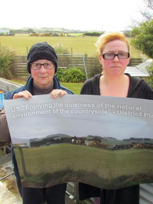 Parsons Rd residents Gen Heselwood (left) and Hayley Kennedy miss their rural view and quietness...