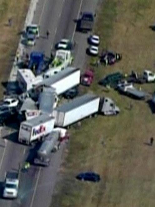 Part of the deadly 120-vehicle pileup is pictured in this still image taken from video courtesy...