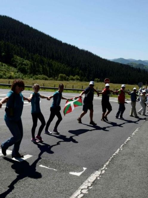 Participants in the human chain linking the Basque town of Durango with the Navarran capital of...