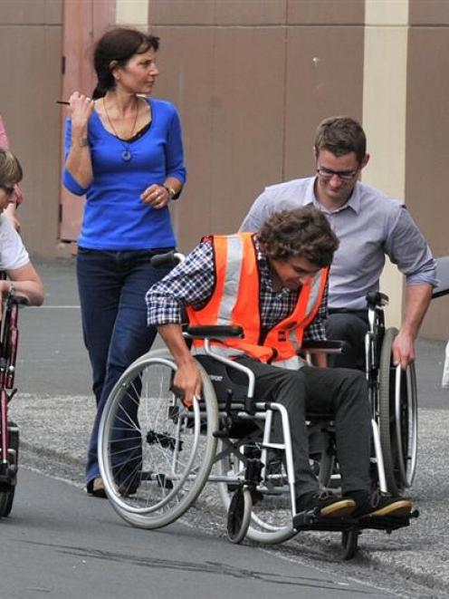 Participating in a disability trial around central Dunedin yesterday are (from left) Sam Riddell,...