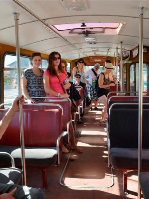 Passengers enjoy riding on a restored bus in Dunedin yesterday. Photo by Gerard O'Brien.