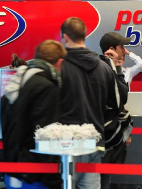 Passengers line up to check in for a flight to Auckland yesterday at Dunedin International...
