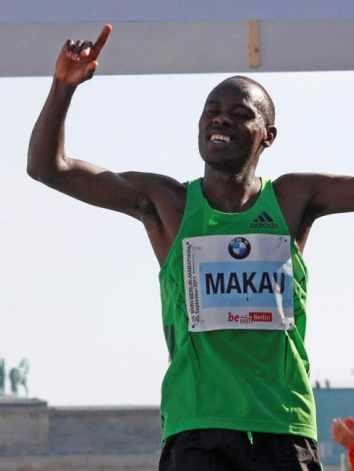 Patrick Makau of Kenya crosses the finish line to win the 38th Berlin Marathon in Berlin in a...