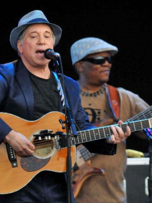 Paul Simon performs the album 'Graceland' live on stage during the third day of Hard Rock Calling...