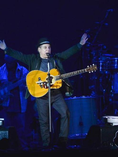 Paul Simon responds to an appreciative crowd at Forsyth Barr Stadium on Saturday night. Photo by...