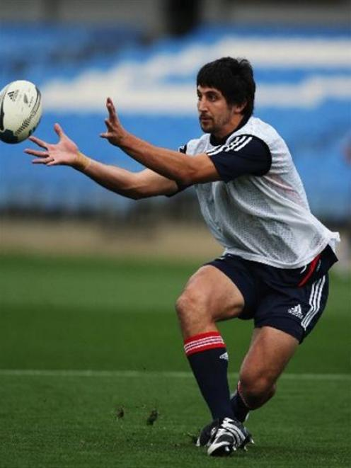 Highlanders fullback Paul Williams receives a pass during an All Black training session at Eden...