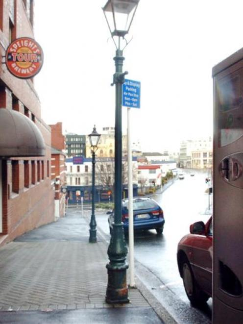 Pay-and-display meters outside Speight's have limited access to the popular spring-water tap (at...