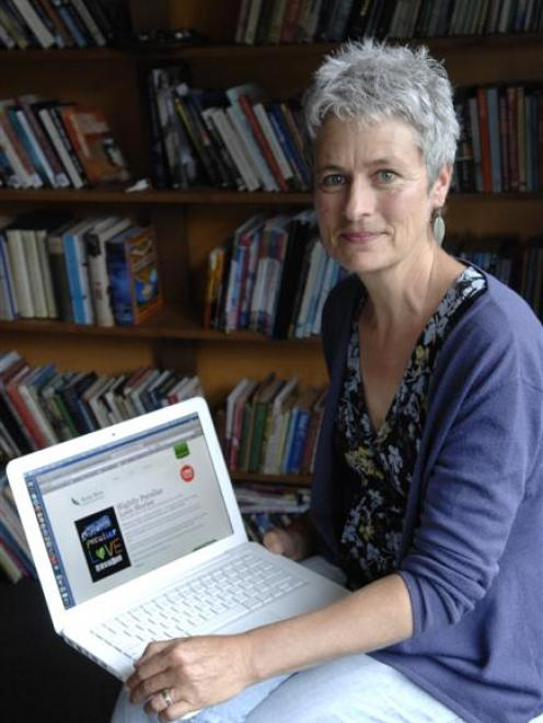 Penelope Todd demonstrates her digital publication Slightly Peculiar Love Stories. Photo by Linda...