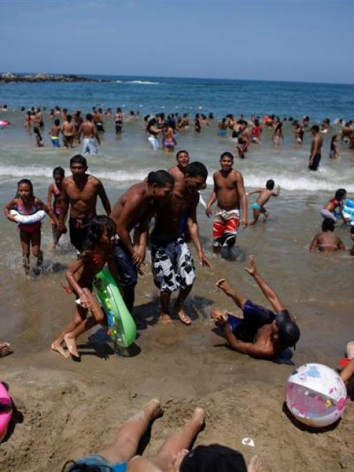 People at a crowded beach in Maiquetia on the outskirts of Caracas. Venezuelans began a week-long...