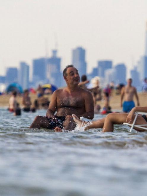 People keep cool at Brighton Beach on January 14, 2014 in Melbourne, Australia. (Photo by Craig...
