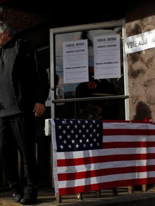 People leave a polling station after casting their ballots during the US presidential election at...