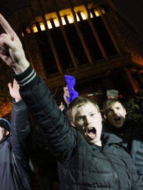 People shout slogans during a pro-Russian rally in Simferopol, Crimea. REUTERS/David Mdzinarishvili