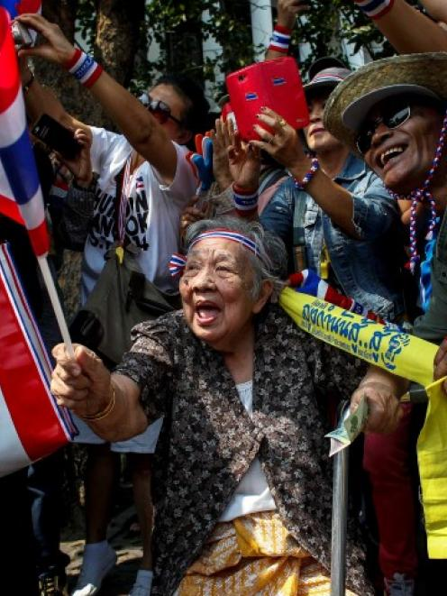 People show their support for anti-government protest leader Suthep Thaugsuban during a march in...
