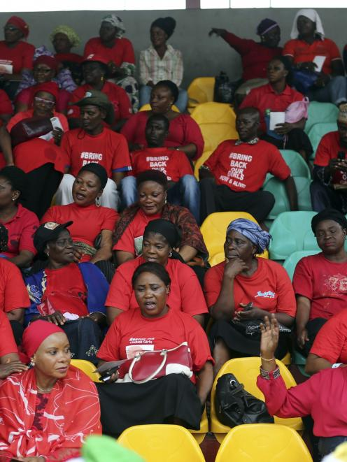 People wearing red gather for a prayer vigil for the release of abducted secondary school girls...