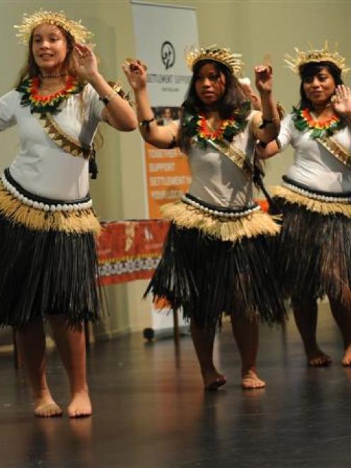 Performing a traditional dance from Kiribati in Dunedin last night are (from left) Roi Burnett ...