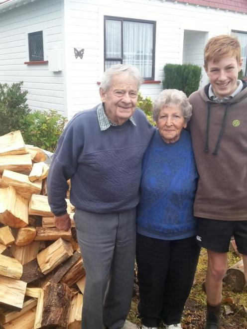 Peter and Daphne Fraser hug Griffin Hadland for delivering a load of firewood to them.  Photo...