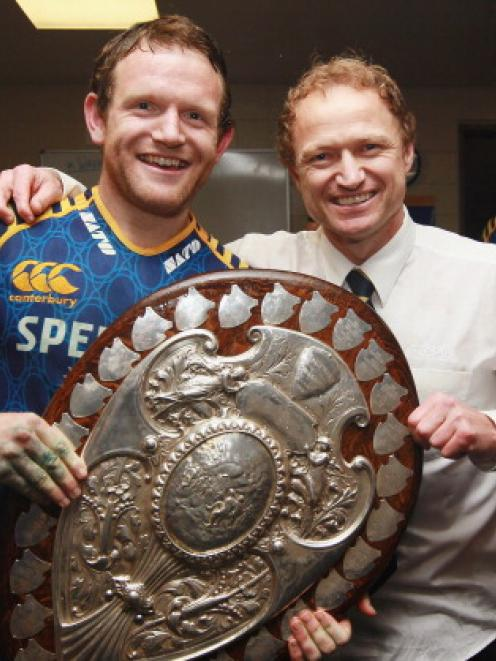 Peter Breen and Otago coach Tony Brown take their turn to pose with the Log o' Wood.