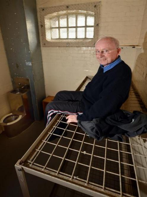 Peter Caswell tests a top bunk for comfort. Photos by ODT.