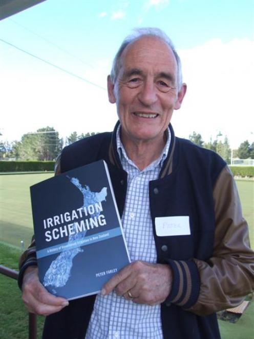 Peter Farley with his newly-launched book, <i>Irrigation Scheming</i>, at the Patearoa Bowling...