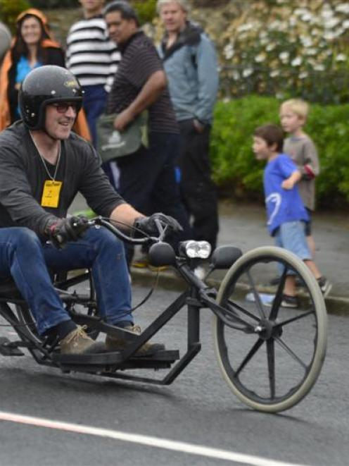 Peter King (left) scoots away in Saturday's trolley derby in Dunedin. Photo by Peter McIntosh.