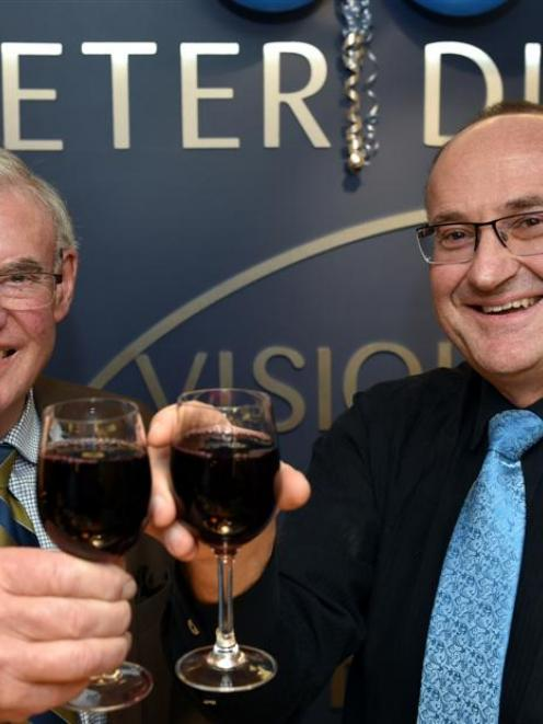 Peter L. Dick and son Peter S. Dick  celebrate 100 years of business in Dunedin yesterday. Photo...