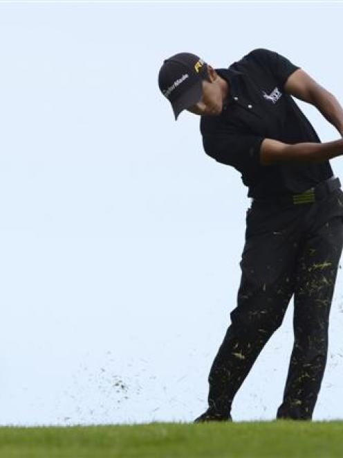 Peter Lee, of Rotorua, plays an approach shot during the South Island strokeplay championship at...