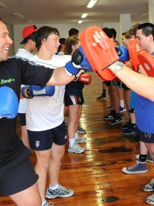 Peter Mirrielees (left) and Eben Joubert show some fitness techniques with a group of school...