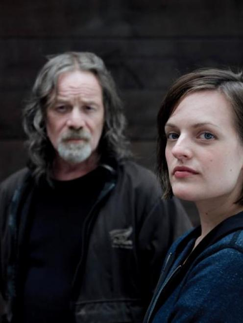 Peter Mullan, as crime lord Matt Mitcham, and Elizabeth Moss, as Detective Robin Givens, star in...