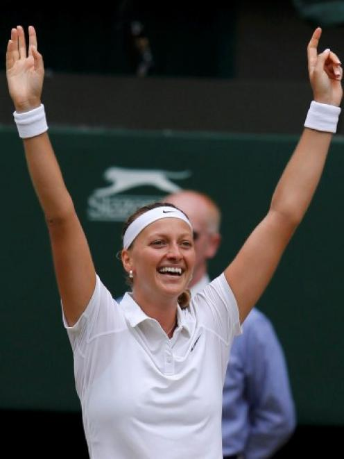 Petra Kvitova celebrates her victory over Eugenie Bouchard. REUTERS/Suzanne Plunkett