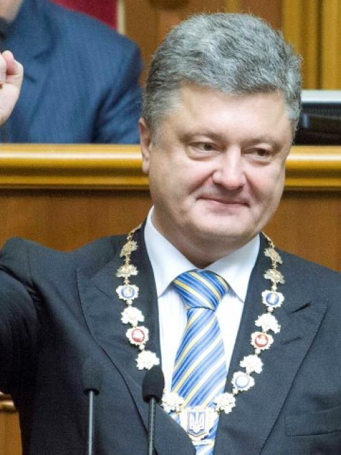 Petro Poroshenko shows the presidential seal during his inauguration ceremony in the parliament...