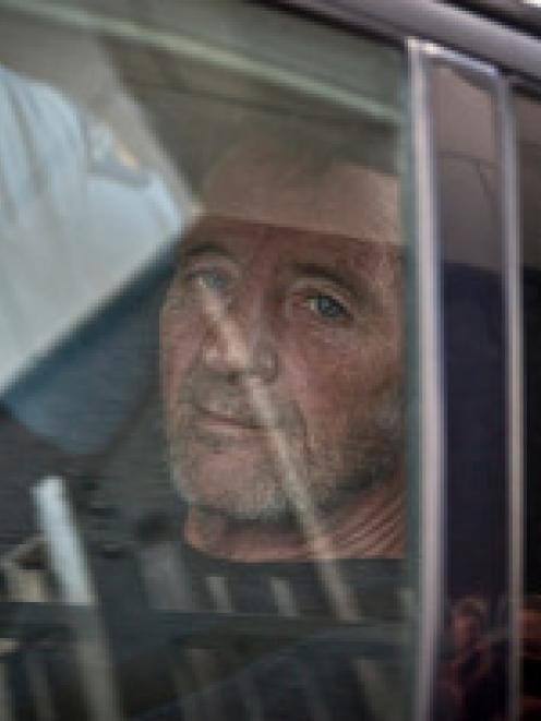 Phil Rudd arrives at the Tauranga Police Station after being detained by police near Tauranga...