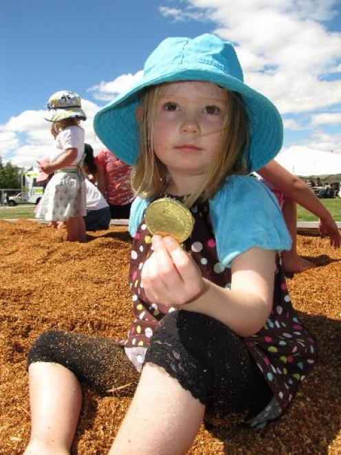 Phoebe Harrex (3), of St Bathans, shows off her prize during the Sawdust Dig for the Kids at the...