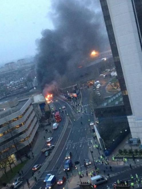 Smoke from a burning helicopter which crashed rises above Vauxhall in central London. REUTERS...