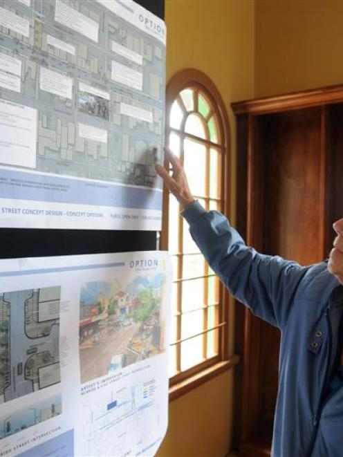 Phyllis Munro, of South Dunedin, considers one of the redevelopment choices for the retail centre...
