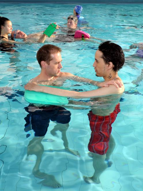 Physiotherapist Mark Shirley (left) helps client Christopher Matahaere in the physio pool, while...