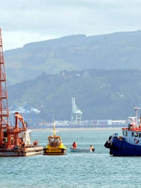 Piles are set into the seabed near the Otakou wharf on Wednesday by Port Otago's pile driver...