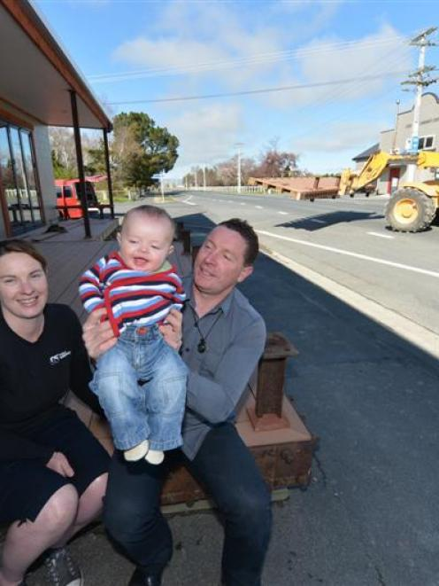 Pip and Dave Thomson, with baby Jules (5 months) at their Middlemarch business, as work to remove...