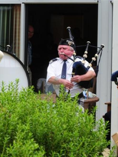 Pipe Major Bill Swift leads members of the Pipes and Drums of Dunedin at the Otago Community...